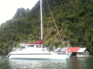 Fishing Village, Langkawi with Cream White Yacht Docking
