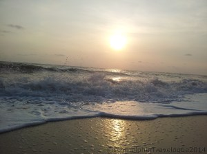 Great waves hitting the shore during sunrise