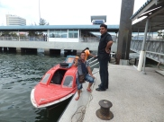 Alighting at Labuan Jetty - Friendly Staff happy to have their photos taken
