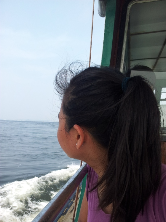 Sister enjoying the boat ride back to Singapore Bye Pulau Ubin