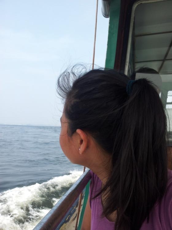 Sister enjoying the boat ride back to Singapore Bye Pulau Ubin