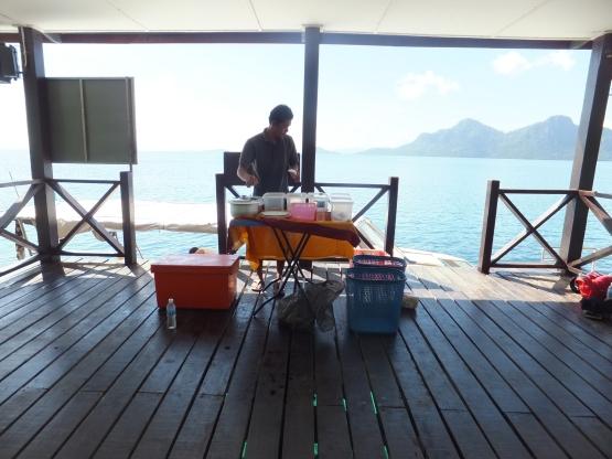 Explore Sabah Day 19: Bohey Dulang, Semporna – Joe setting up lunch at Bohey Dulang Jetty