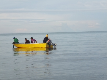 Wondering what the locals on sampan boat at Tg. Aru Beach in the waters of South China Sea are doing...