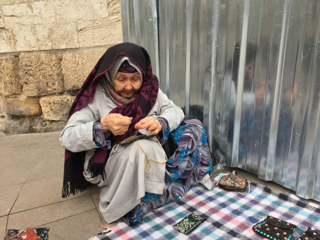 Istanbul Old Lady Street Seller Sewing Her Handmade Pouch