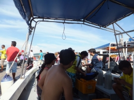 PADI Discover Scuba Diving (DSD) in Tunku Abdul Rahman Park, Sabah getting ready in boat