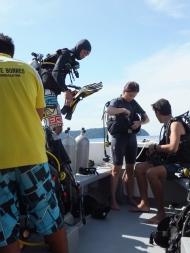 PADI Discover Scuba Diving (DSD) in Tunku Abdul Rahman Park, Sabah in Boat - Advanced Divers Preparing to Dive